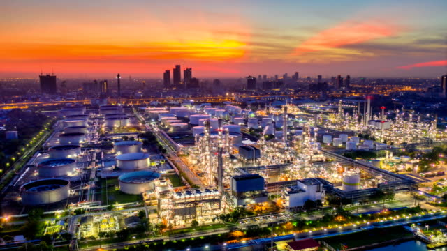 Night to Day 4K Timelapse or Hyperlapse of Aerial of industrial park with oil refinery and storage tank in Asia at Sunrise 4K Timelapse or Hyperlapse of Aerial of industrial park with oil refinery near river in Asia at Sunrise power stock videos & royalty-free footage