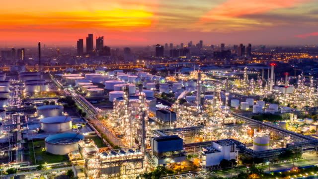 night to day 4k timelapse or hyperlapse of aerial of industrial park with oil refinery and storage tank in asia at sunrise - очистительный завод стоковые видео и кадры b-roll