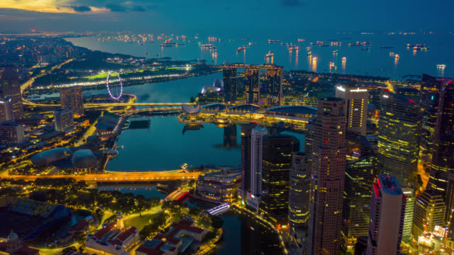 Night to day Hyperlapse or Dronelapse scene of Singapore business district downtown at sunrise Night to day Hyperlapse or Dronelapse scene of Singapore business district downtown at sunrise singapore architecture stock videos & royalty-free footage