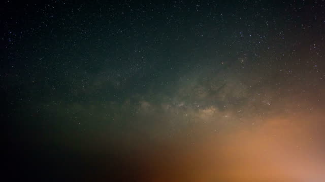 Night to Day Shot of Milky Way Galaxy and Mountains