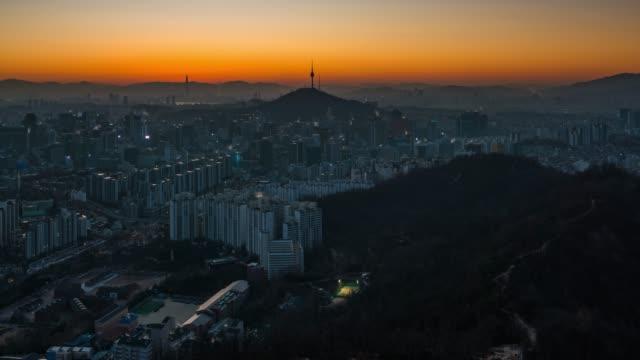 Night to day timelapse sunrise scene of Seoul downtown city skyline