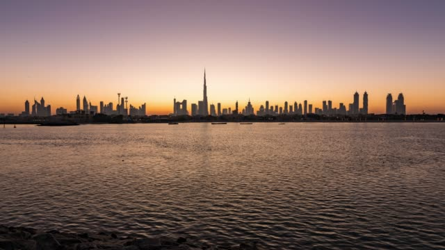 night to day/time lapse dubai skyline at sunrise / dubai, uae - dubai architecture stock videos & royalty-free footage