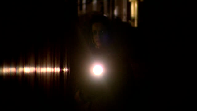 Night Torch Woman Woman walking towards camera with a torch. Good material for a night suspense trailer or item on personal safety. flashlight stock videos & royalty-free footage
