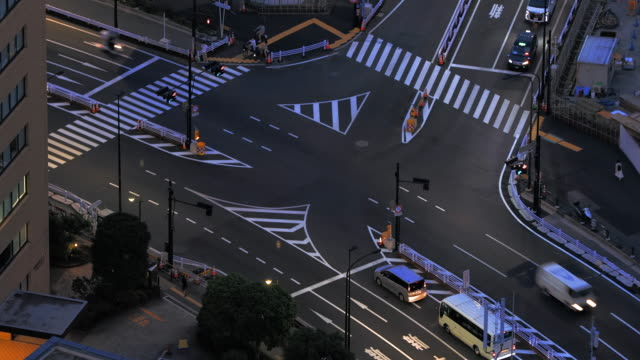Night traffic intersection with cars