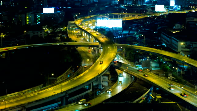 Night traffic Time-Lapse. Time-lapse,Video angle, visibility, traffic and city at night ,Road area of the s curve.The road is similar to the English letter X. generation x stock videos & royalty-free footage