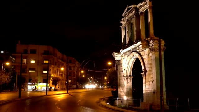 Night view from downtown Athens. Arch of Hadrian that leads to the pillars of Zeus's archaeological site video