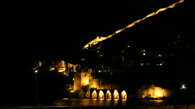 Night view of Alanya castle and historical shipyard video
