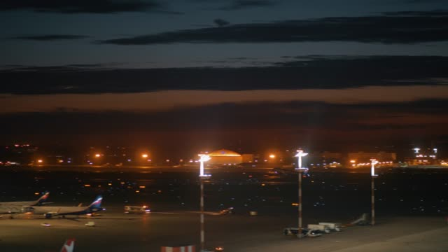 Night view of Sheremetyevo Airport with plane taking off, Moscow