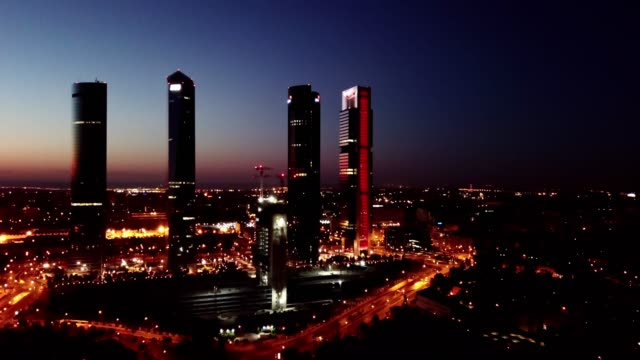 Night view of the four towers   in Madrid Night view of the four towers (Cuatro Torres) of the business district in Madrid. Spain sorpresa stock videos & royalty-free footage