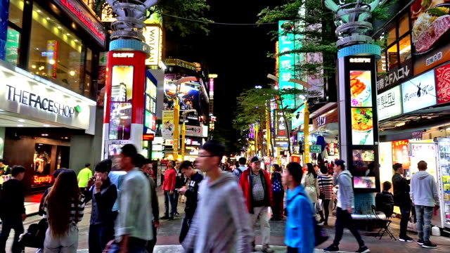 Night view of young customers wander at Ximending shopping street, Taipei, China video
