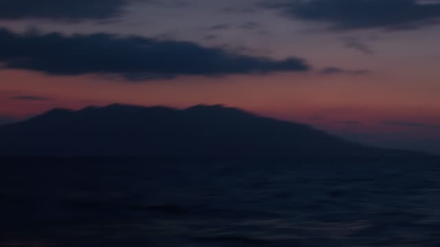 Night yachting at Aegean Sea Sailing with a yacht at night during a sailing trip in Cyclades, Aegean Sea, Mediterranean, Greece. aegean islands stock videos & royalty-free footage