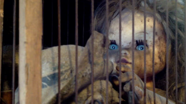 nightmare  child abuse and abduction or depression girl puppet in an old cage doll stock videos & royalty-free footage