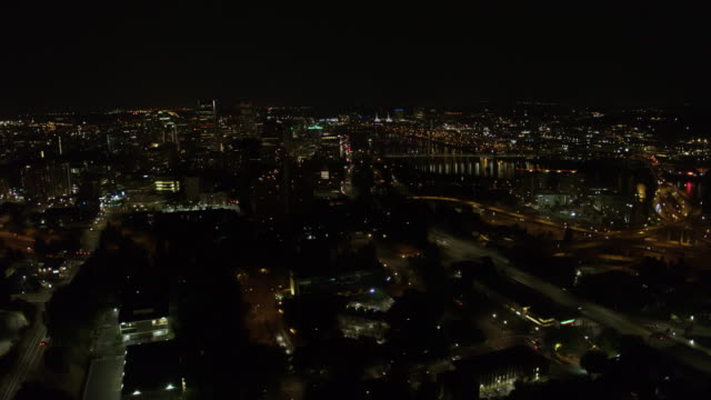 Nighttime drone aerial panning shot of downtown Portland Oregon  including the  Tilikum Bridge, the towers over the convention center video