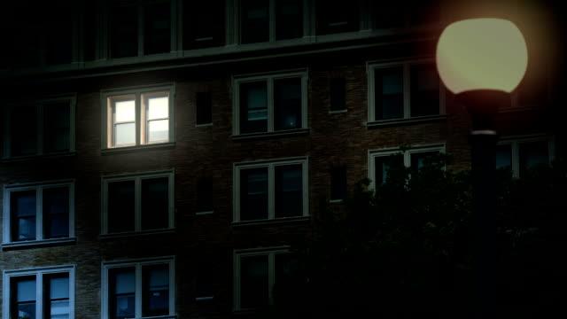 nighttime establishing shot of late night worker in office building - appartamento video stock e b–roll