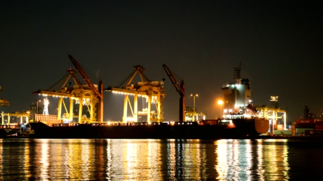 nighttime industrial container cargo freight ship with working crane river side at bangkok thailand. - rotterdam video stock e b–roll