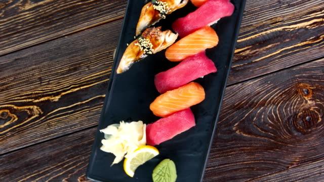 Nigiri sushi on a plate. Nigiri sushi on a plate. Tasty japanese food. sesame stock videos & royalty-free footage