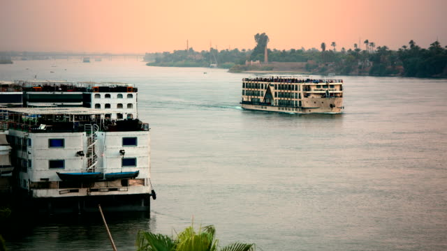 Nile River cruise ship at sunset near Luxor Egypt video