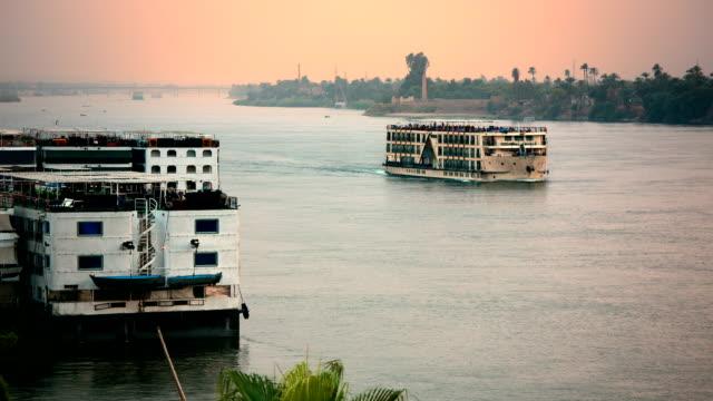 Nile River cruise ship at sunset near Luxor Egypt video