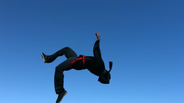 Ninja flips in air, slow motion  ninja stock videos & royalty-free footage