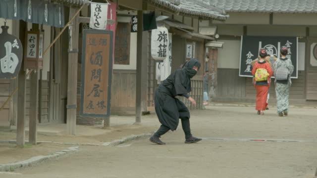 Ninja is behind.Japanese retro town. Ninja is behind.Japanese retro town. ninja stock videos & royalty-free footage
