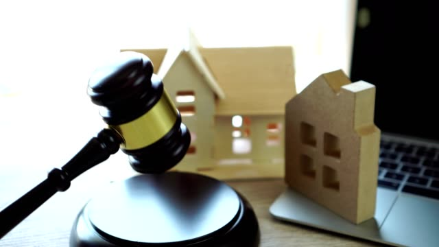 nline auction for real estate home ownership, buying selling or foreclosure concept. judge gavel house model on computer. idea for housing business judgment by e-commerce online digital over internet - foreclosure stock videos & royalty-free footage