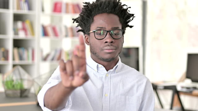 No, African Man Disapproving by Finger Sign