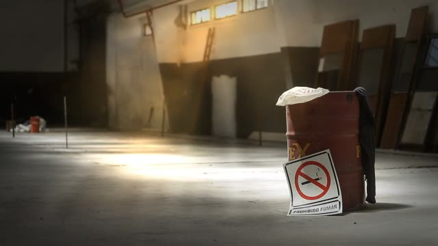 No Smoking Sign in an Empty Warehouse.