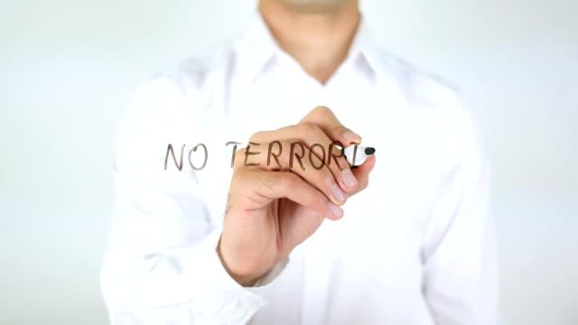 No Terrorism, Man Writing on Glass video