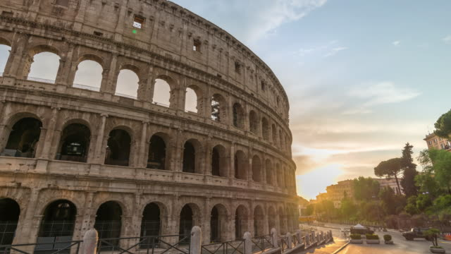 Nobody empty of Rome Italy time lapse 4K due to Coronavirus Covid-19 lockdown, city skyline sunset timelapse at Rome Colosseum