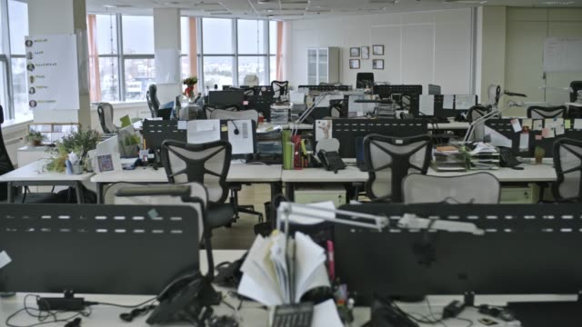 Nobody Working in Office Tracking shot of big empty office with large windows and various objects on tables, shot in daytime barren stock videos & royalty-free footage