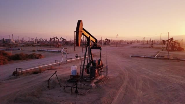 Nodding Pumpjack Among Many in Midway-Sunset Oil Field, Kern County, California video