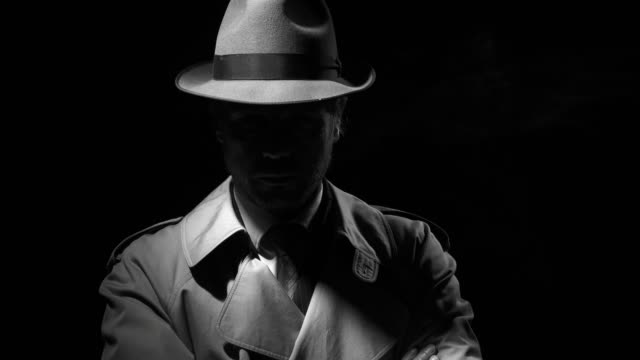 noir film investigator standing in the dark - mistero video stock e b–roll