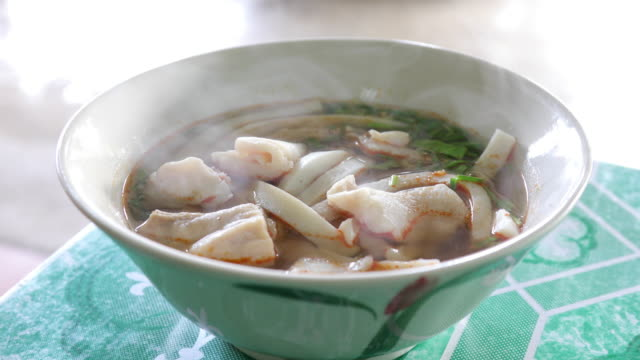 Noodles with fish balls in bowl video