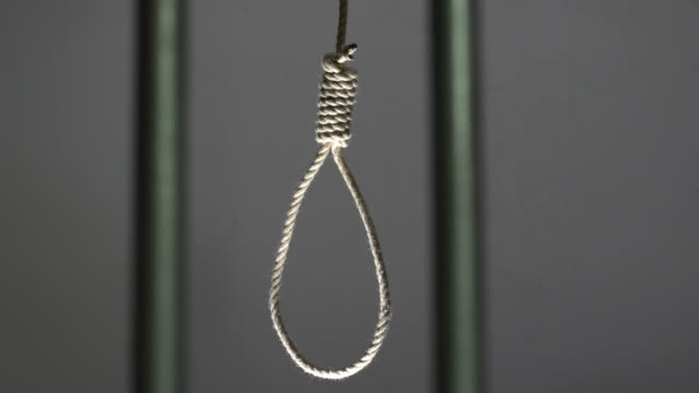 4K DOLLY: Noose hanging in prison / jail cell video