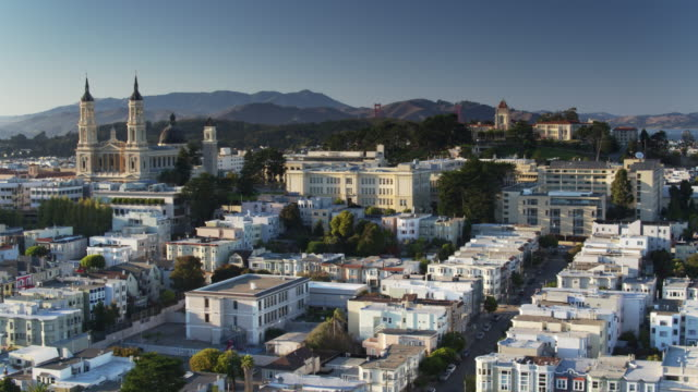 NoPa, San Francisco - Aerial View Aerial shot of San Francisco from over the Panhandle, taking in the University of San Francisco and the houses of NoPa, with the Presidio and Golden Gate Bridge in the distance. western usa stock videos & royalty-free footage