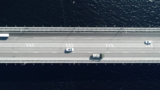 Nord Aerial view of highway and bridge in city on a sun day Nord Aerial view of highway and bridge in city on a sun day directly above stock videos & royalty-free footage