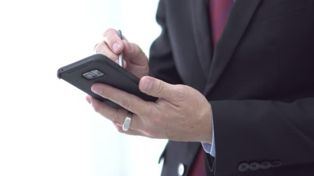 Normal shot Asia businessman use mobile and digital pen