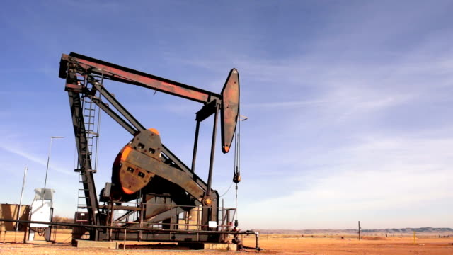 North Dakota Oil Pump Jack Fracking Crude Extraction Machine video