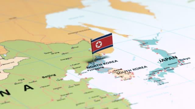north korea with national flag - corea del sud video stock e b–roll