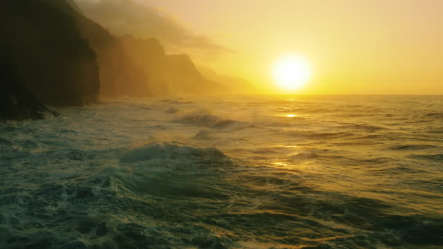 north shore kauai, na pali coast, ke'e beach - sunset stock videos & royalty-free footage