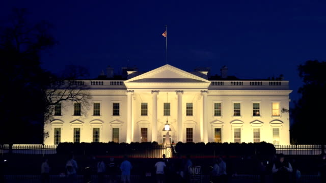 north side of the white house at night in washington, d.c.