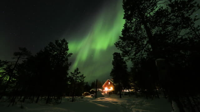 northern lights above frozen country above arctic in finland - aurora boreale video stock e b–roll