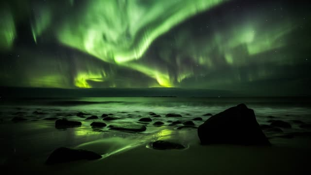 northern lights at utakleiv beach in norway - aurora boreale video stock e b–roll