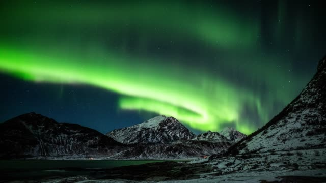 northern lights over arctic landscape in norway - aurora boreale video stock e b–roll