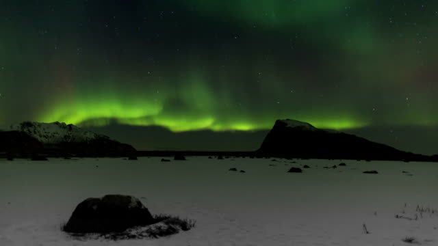 Northern Lights over the frozen Arctic fjord - solar storm video