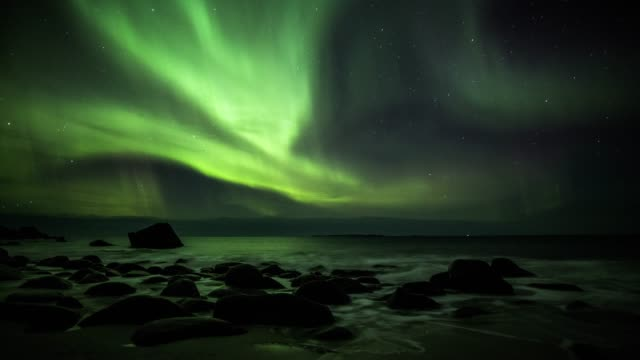 northern lights over the lofoten islands in norway - aurora boreale video stock e b–roll