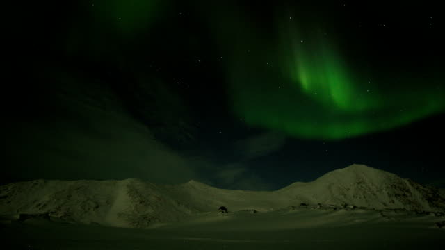 northern lights over the mountains. spitsbergen, arctic. - antarctica travel stock videos & royalty-free footage