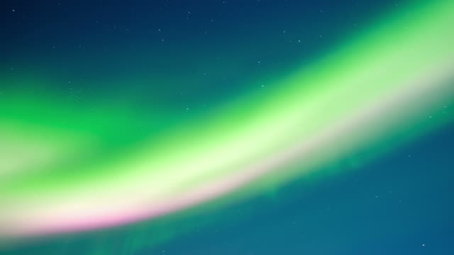 northern lights, polar light or aurora borealis in the night sky time lapse over norway - aurora boreale video stock e b–roll