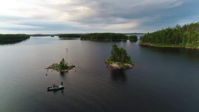 Northern river and forest aerial filming