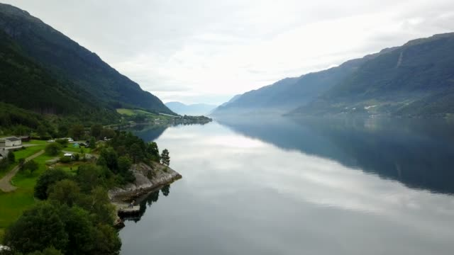 norway - ideal fjord reflection in clear water from drone on air - fiordo video stock e b–roll